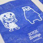 熊本大分大震災の支援の輪を「ジャー坊×くまモン」コラボブルーシードバッグ